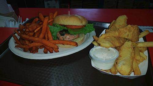 Grilled Salmon Burger with Sweet Potato Fries and Scrod with Fries